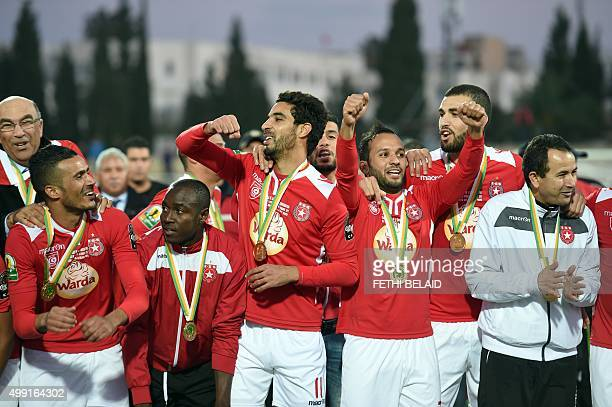 Etoile du Sahel players celebrate winning the CAF trophy after defeating the Orlando Pirates during the second final of the 2015 CAF Confederation of...