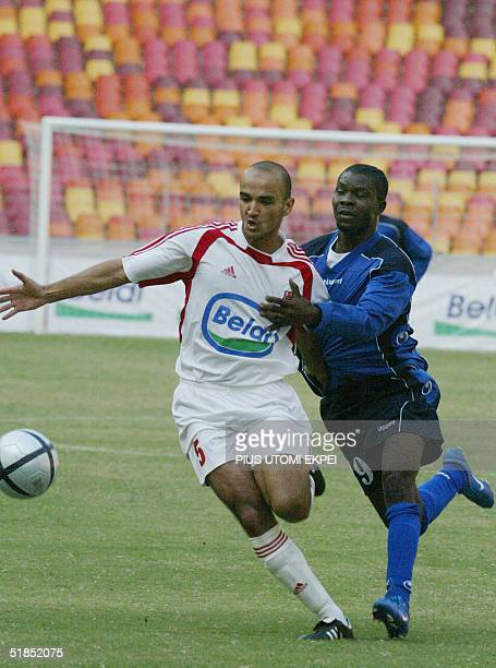 Etoile Sahel's defender Mohamed Jedidi tries to stop Enyimba's Ndidi Anumnu Saturday 12 December 2004 during the CAF Cup final match between Enyimba...