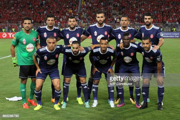 Etoile's starting evelen pose for a group picture during the CAF Champions League semifinal football match between AlAhly vs Etoile du Sahel at the...