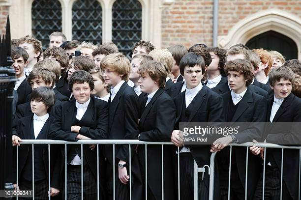 Eton pupils look on as Queen Elizabeth II and Prince Philip Duke of Edinburgh attend the 150th Anniversary of the Eton Combined Cadet Force at Eton...