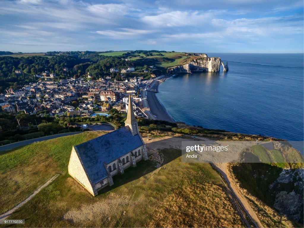 the coastline and the Chapel of Notre-Dame-de-la-Garde, the town and cliffs along the 'Cote d'Albatre' coast.