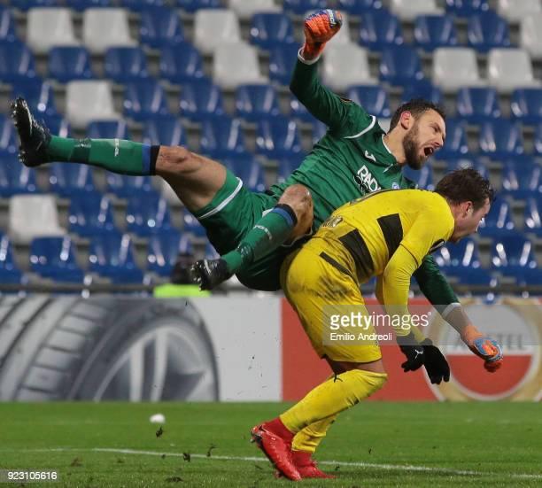 Etrit Berisha of Atalanta BC clashes with Mario Gotze of Borussia Dortmund during UEFA Europa League Round of 32 match between Atalanta and Borussia...