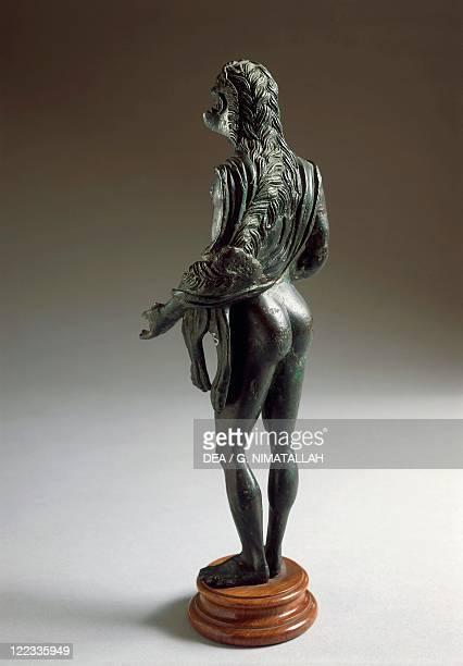 Etruscan civilization 4th century bC Bronze statue depicting Heracle resting circa 300 bC From Poggio Castiglione Massa Marittima