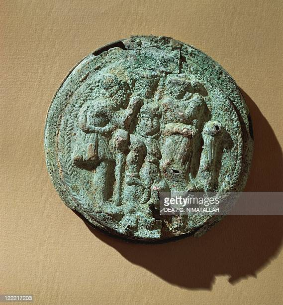 Etruscan civilization, 5th century b.C. Embossed bronze mirror casket depicting Ulysses, Penelope and dog Argus.