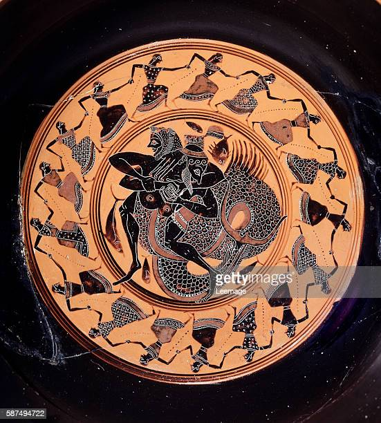 Terracotta kylix representing Hercules fighting with Triton 6th century BC Tarquinia archaeological museum Lazio Italy