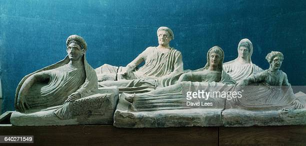 Etruscan sarcophagus lids depicting deceased men and women | Located in Italy