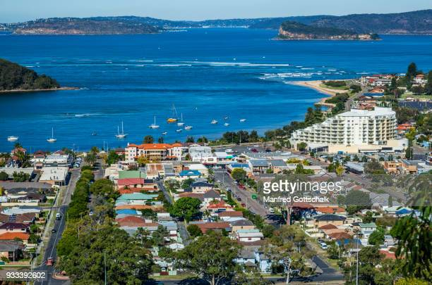 ettalong commercial centre with the mantra ettalong beach resort and the entrance to brisbane water brisbane water and broken bay, central coast, new south wales - new south wales stock pictures, royalty-free photos & images