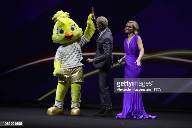 Ettie the Women's World Cup mascot and host Denis Brogniart and Amanda Davies on stage during the FIFA Women's World Cup France 2019 Draw at La Seine...