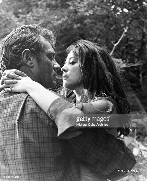 Ettore Manni and Jeanne Moreau passionately looking into one an others eyes in a scene from the film 'Mademoiselle', 1966.