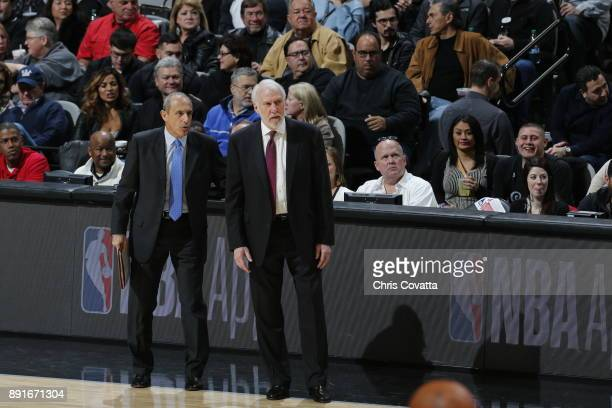 Ettore Messina and Gregg Popovich of the San Antonio Spurs during the game against the Boston Celtics on December 8 2017 at the ATT Center in San...