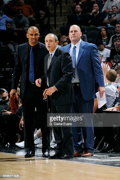 Ettore Messina and the San Antonio Spurs coaching staff stand on the court during a game against the Indiana Pacers at the ATT Center on November 26...