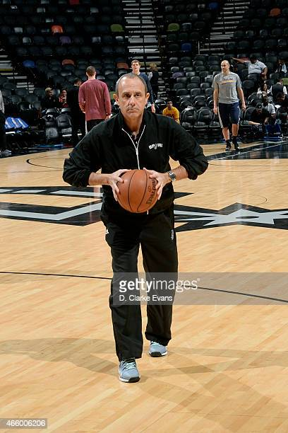Ettore Messina assistant coach of the San Antonio Spurs helps the team warm up before a game against the Cleveland Cavaliers at the ATT Center on...