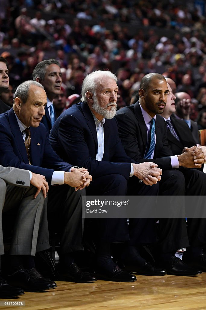 Ettore Messina, Gregg Popovich and Ime Udoka of the San Antonio Spurs watch the game from the bench during the game against the Phoenix Suns as part of NBA Global Games at Arena Ciudad de Mexico on January 14, 2017 in Mexico City, Mexico.