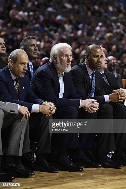 Ettore Messina Gregg Popovich and Ime Udoka of the San Antonio Spurs watch the game from the bench during the game against the Phoenix Suns as part...