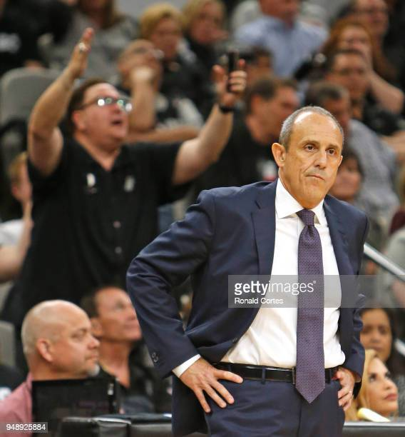 Ettore Messina looks on as a fan protest a foul not called against the Golden State Warriors at AT&T Center on April 19 , 2018 in San Antonio, Texas....