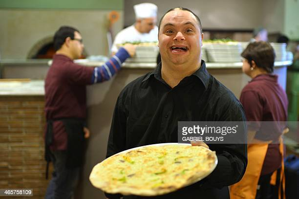 Ettore Tommasetti a young man with Down syndrome works in the restaurant 'Locanda dei Sunflowers' on January 28 2014 in Rome This restaurant is born...