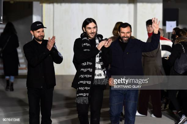 Etudes studios owners Aurelien Arbet and Jeremie Egry and designer Jose Lamali salute after the show during the men's Fashion Week for the...