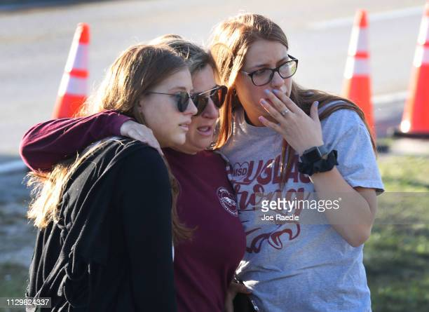 Emma Rothenberg and her sister Sophia Rothenberg stand with their mother Cheryl Rothenberg as they become emotional while looking on at a memorial...