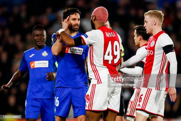 Etxeita of Getafe CF Ryan Babel of Ajax Donny van de Beek of Ajax during the UEFA Europa League match between Getafe v Ajax at the Coliseum Alfonso...