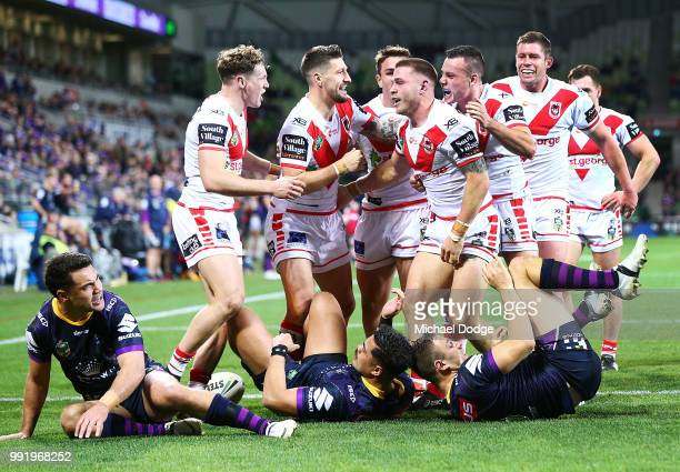 Euan Aitken of the Dragons celebrates a try with teammates during the round 17 NRL match between the Melbourne Storm and the St George Illawarra...