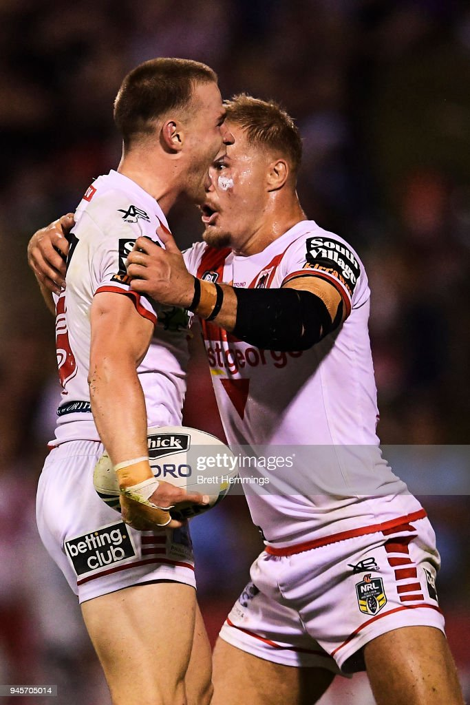 Euan Aitken of the Dragons celebrates scoring a try with Jack De Belin of the Dragons during the round six NRL match between the St George Illawarra Dragons and the Cronulla Sharks at WIN Stadium on April 13, 2018 in Wollongong, Australia.