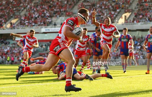 Euan Aitken of the Dragons crosses to score a try during the round four NRL match between the St George Illawarra Dragons and the Newcastle Knights...