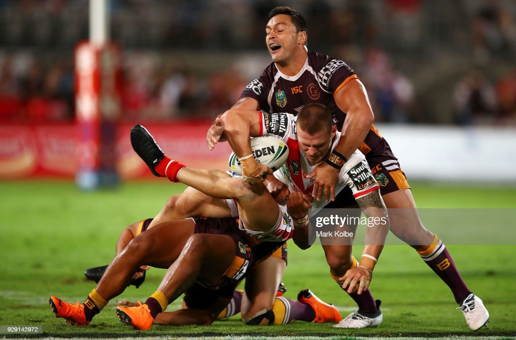 Euan Aitken of the Dragons is tackled Alex Glenn of the Broncos during the round one NRL match between the St George Illawarra Dragons and the Brisbane Broncos at UOW Jubilee Oval on March 8, 2018 in Sydney, Australia.