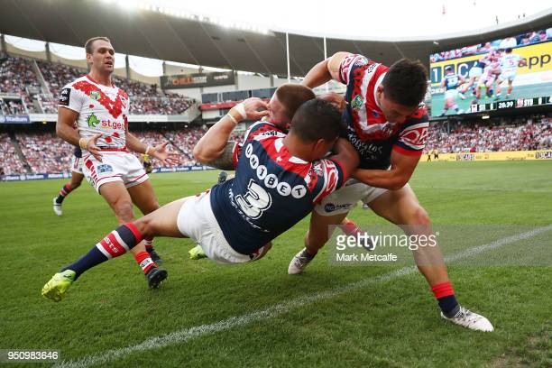 Euan Aitken of the Dragons is tackled by Latrell Mitchell of the Roosters during the round eight NRL match between the St George Illawara Dragons and...