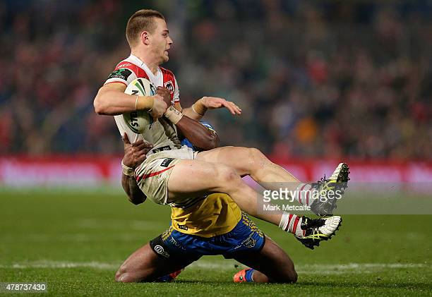 Euan Aitken of the Dragons is tackled by Semi Radradra of the Eels during the round 16 NRL match between the Parramatta Eels and the St George...
