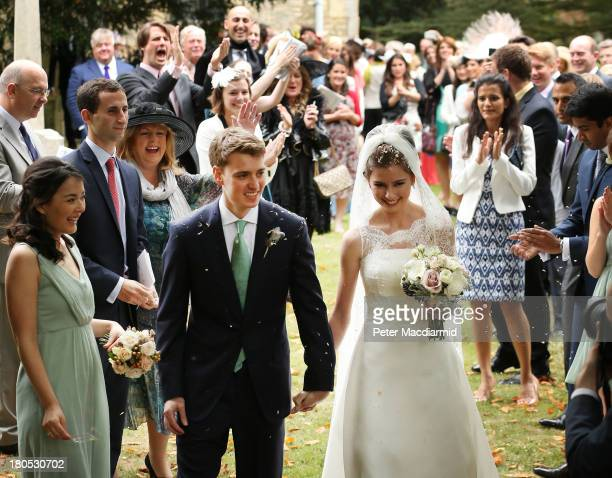 Euan Blair and his new wife Suzanne leave All Saints Church after getting married on September 14 2013 in Wotton Underwood England Euan Blair son of...