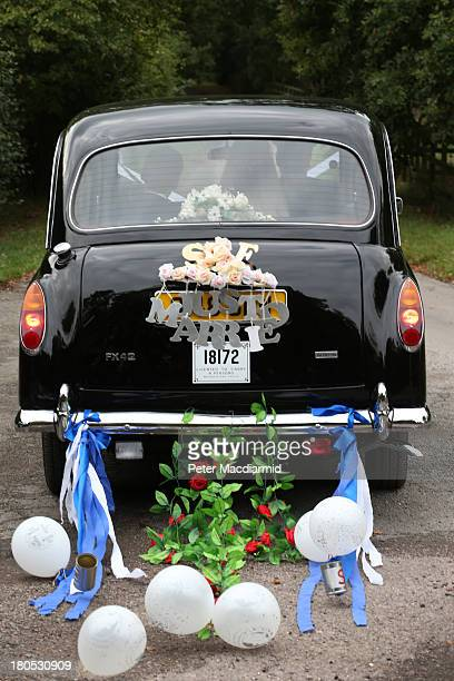 Euan Blair and his new wife Suzanne leave All Saints Church in a decorated London taxi after getting married on September 14 2013 in Wotton Underwood...