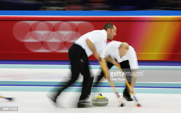Euan Byers of Great Britain and Ewan MacDonald compete during the preliminary round of the men's curling between Great Britain and Switzerland during...