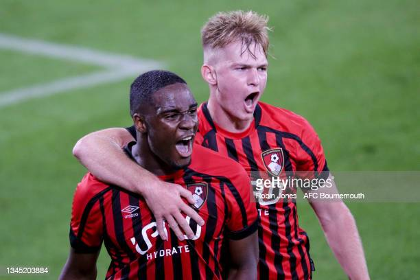 Euan Pollock of Bournemouth congratulates team-mate Christian Saydee after he scores a goal to make it 1-1 during the Premier League Cup match...