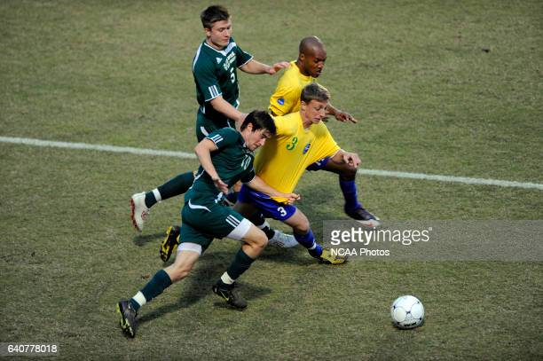 Euan Purcell and Sam Morris of Fort Lewis battle for the ball with David Palmer and Dale Parker of LeesMcRae during the Division II Men's Soccer...