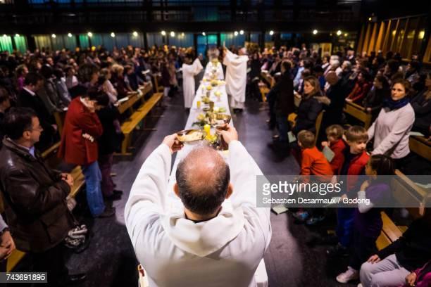 Eucharist celebration in a Paris catholic church. France.