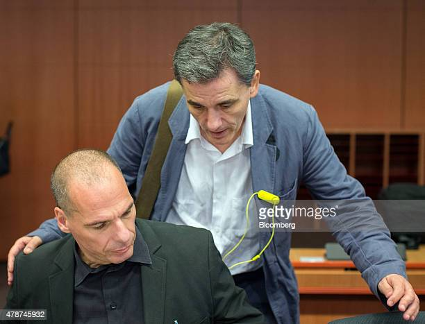 Euclid Tsakalotos Greece's deputy foreign minister right speaks with Yanis Varoufakis Greece's finance minister as they prepare for the start of the...