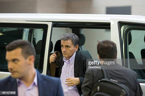 Euclid Tsakalotos Greece's finance minister center arrives for a Eurogroup meeting in Luxembourg on Monday Oct 5 2015 French Finance Minister Michel...
