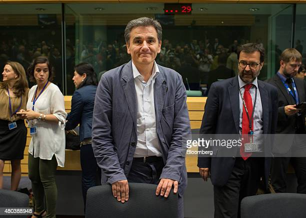 Euclid Tsakalotos Greece's finance minister center stands ahead of a meeting of European finance ministers in Brussels Belgium on Saturday July 11...