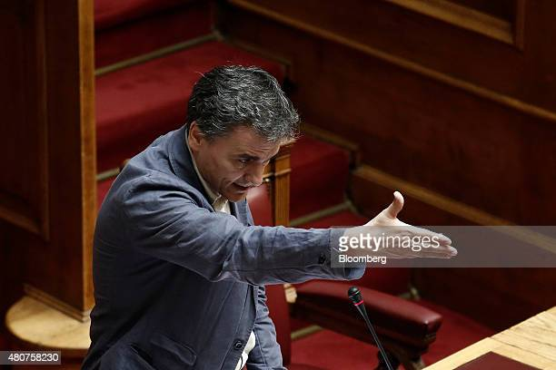 Euclid Tsakalotos Greece's finance minister gestures whilst speaking to lawmakers in the Greek parliament in Athens Greece on Wednesday July 15 2015...