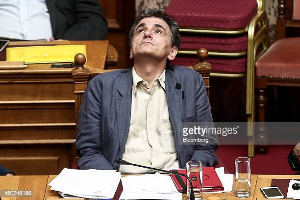 Euclid Tsakalotos Greece's finance minister pauses as he attends a parliamentary session with Yannis Dragasakis Greece's deputy prime minister right...