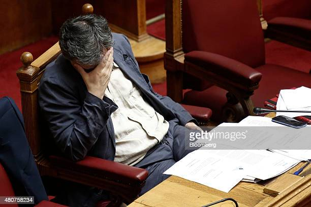 Euclid Tsakalotos Greece's finance minister pauses while attending a parliamentary meeting in Athens Greece on Wednesday July 15 2015 Parliament will...