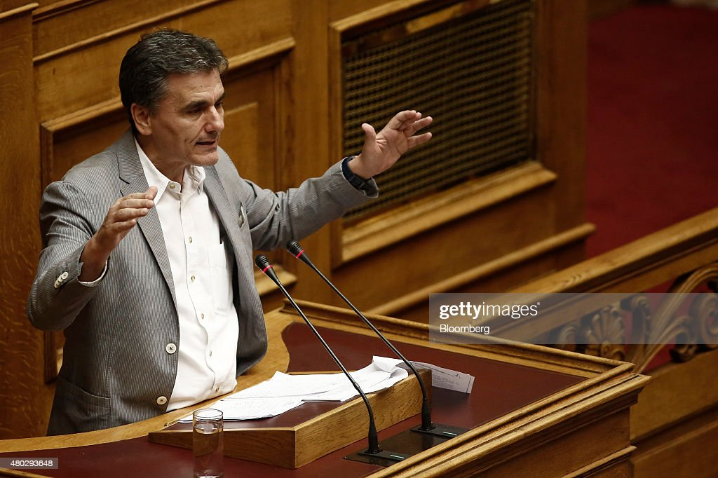 Euclid Tsakalotos, Greece's Finance minister, speaks at the Greek parliament in Athens, Greece, on Saturday, July 11, 2015. Greek lawmakers debated Prime Minister Alexis Tsiprasâs bailout proposal into the early hours of Saturday before a weekend of political wrangling with creditors on his nationâs place in the euro. Photographer: Kostas Tsironis/Bloomberg via Getty Images
