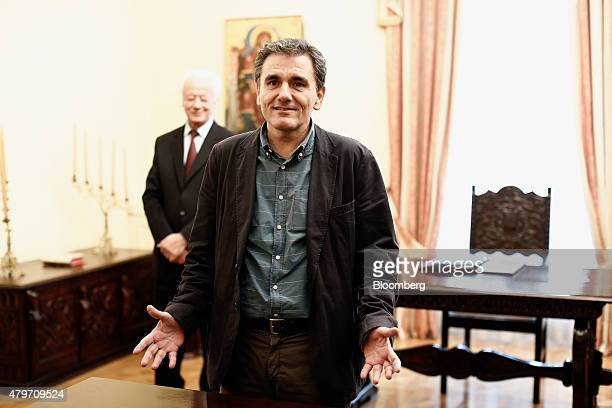 Euclid Tsakalotos Greece's finance minister takes a political oath following his appointment at the Presidential Palace in Athens Greece on Monday...