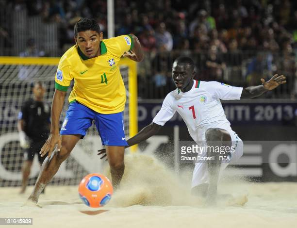 Eudin of Brazil is challenged by Babacar Fall of Senegal during the FIFA Beach Soccer World Cup Tahiti 2013 Group C match between Brazil and Senegal...
