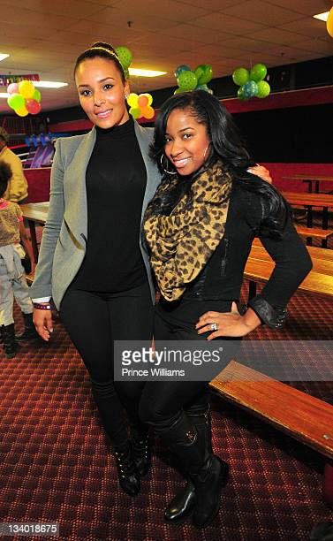 Eudoxie and Antonia Wright attend the 2011 Roll Over Hunger Charity and Skate Jam at the Cascade Family Skating Rink on November 23, 2011 in Atlanta,...