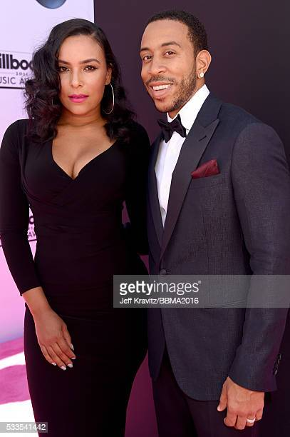Eudoxie Mbouguiengue and cohost Chris 'Ludacris' Bridges attend the 2016 Billboard Music Awards at TMobile Arena on May 22 2016 in Las Vegas Nevada