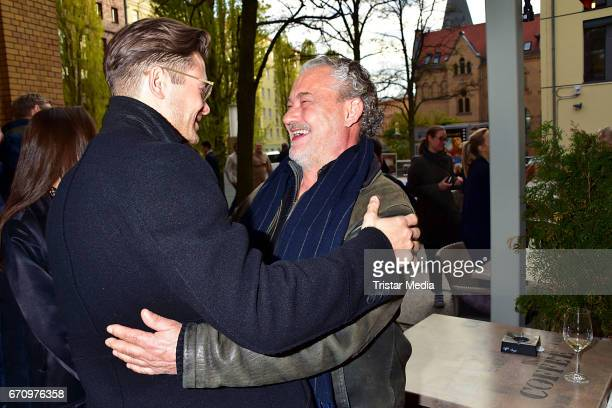 Eugen Bauder and Rolf Kanies attend the family and friends screening of the film 'Einsamkeit und Sex und Mitleid' on April 20 2017 in Berlin Germany