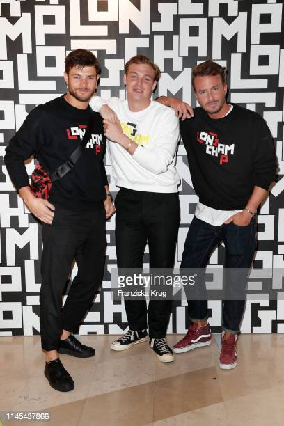 Eugen Bauder David Schuetter and Dennis Sialkowski attend the Longchamp store event on May 21 2019 in Munich Germany