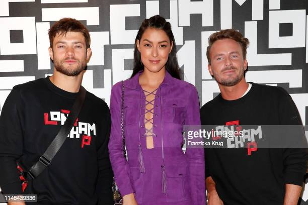 Eugen Bauder Rebecca Mir and Dennis Sialkowski attend the Longchamp store event on May 21 2019 in Munich Germany