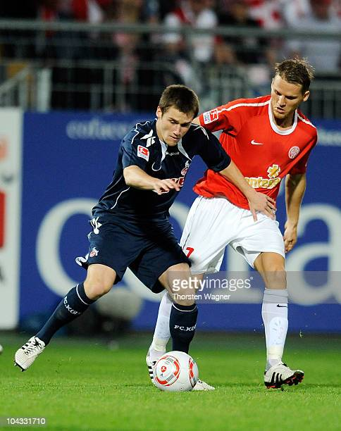 Eugen Polamnski of Mainz battles for the ball with Christian Clemens of Koeln during the Bundesliga match between FSV Mainz 05 and 1.FC Koeln at...